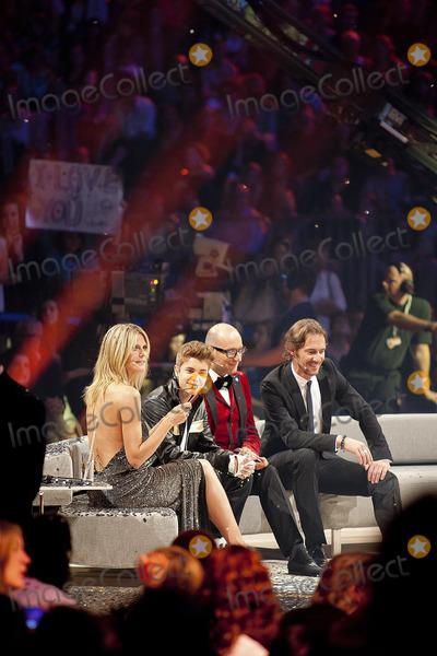 Thomas Hayo Photo - Heidi Klum Thomas Rath Thomas Hayo und Justin Bieber at the finals of Germanys Next Topmodel at the Koelnarena Cologne Germany 07062012Credit wcrARTface to face