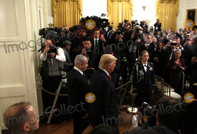 Benjamin Netanyahu Photo - United States President Donald J Trump and Israels Prime Minister Benjamin Netanyahu enter the East Room of the White House during a meeting in Washington DCon Tuesday January 28 2020 Credit Joshua Lott  CNPAdMedia
