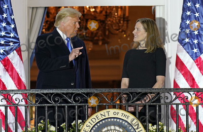The Ceremonies Photo - United States President Donald J Trump gestures towards Justice Amy Coney Barrett following the ceremony where she took the oath of office to be Associate Justice of the Supreme Court on the Blue Room Balcony of the White House in Washington DC US October 26 2020 Credit Chris Kleponis  Pool via CNPAdMedia