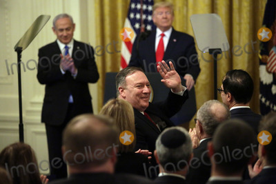 Benjamin Netanyahu Photo - US Secretary of State Mike Pompeo acknowledges the crowd as United States President Donald J Trump met with Israels Prime Minister Benjamin Netanyahu during a meeting in the East Room of the White House in Washington DCon Tuesday January 28 2020 Credit Joshua Lott  CNPAdMedia