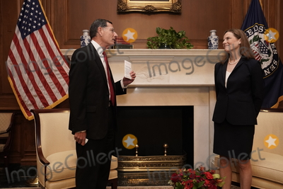 The Used Photo - United States Supreme Court nominee and US Court of Appeals Judge Amy Coney Barrett listens during a meeting with United States Senator John Barrasso (Republican of Wyoming) who is holding a copy of the US Constitution on Capitol Hill in Washington US October 21 2020Credit Ken Cedeno  Pool via CNPAdMedia