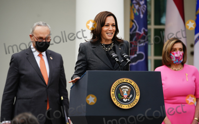 Nancy Pelosi Photo - Senate Majority leader Chuck Schumer (L) and Speaker of the House Nancy Pelosi (R) listen as US Vice President Kamala Harris delivers remarks on the American Rescue Plan from the Rose Garden of the White House in Washington DC USA 12 March 2021 President Biden signed the massive 19 trillion USD (1589 trilllion euro) coronavirus relief package into law on 11 MarchCredit Jim LoScalzo  Pool via CNPAdMedia