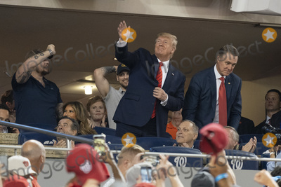 TI Photo - 27 October 2019- Washington DC- United States President Donald J Trump acknowledges the crowd during a moment to salute the military during game five of the World Series at Nationals Park in Washington DC on October 27 2019 The Washington Nationals and Houston Astros are tied at two games going into tonights game Pictured at right is United States Senator David Perdue (Republican of Georgia) Credit Chris Kleponis  Pool via CNPAdMedia
