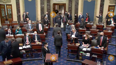 The Used Photo - In this image from United States Senate television the US House managers depart after hearing the verdict of the Senate on the single Article of Impeachment against former US President Donald J Trump during Day 5 of the second impeachment trial of the former president in the US Senate in the US Capitol in Washington DC on Saturday February 13 2021Mandatory Credit US Senate TV via CNPAdMedia