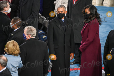 Michelle Obama Photo - Former US President Barrack Obama (C) and Michelle Obama look on as former US President George W Bush (2ndL) wait before US president-elect Joe Biden is sworn in as the 46th US President on January 20 2021 at the US Capitol in Washington DC - Biden a 78-year-old former vice president and longtime senator takes the oath of office at noon (1700 GMT) on the US Capitols western front the very spot where pro-Trump rioters clashed with police two weeks ago before storming Congress in a deadly insurrection (Photo by Saul LOEB  POOL  AFP)AdMedia