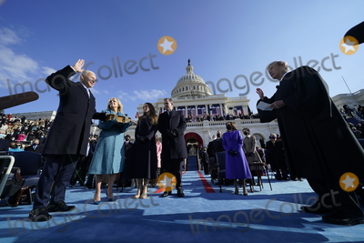 The Unit Photo - Joe Biden is sworn in as the 46th president of the United States by Chief Justice John Roberts as Jill Biden holds the Bible during the 59th Presidential Inauguration at the US Capitol in Washington Wednesday Jan 20 2021 (AP PhotoAndrew Harnik Pool)AdMedia
