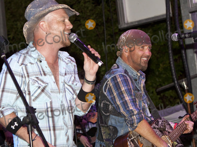 LoCash Cowboys Photo - June 11 2011 - Woodstock GA - Chris Lucas and Preston Brust The LoCash Cowboys headlined at the Woodstock Summer Concert Series and performed songs from their current album for a large crowd Photo credit Dan HarrAdMedia