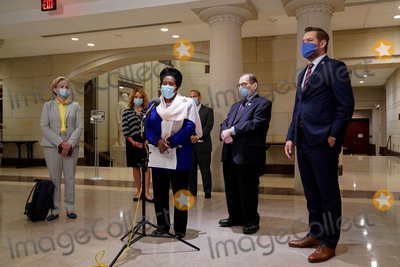 Train Photo - United States Representative Sheila Jackson Lee (Democrat of Texas) US Representative Jerrold Nadler (Democrat of New York) Chairman US House Judiciary Committee and other Democratic members of the House Judiciary Committee speak to reporters during a break in a meeting to markup HR 7120 the Justice in Policing Act of 2020 in Washington DC US on Wednesday June 17 2020 The House bill would make it easier to prosecute and sue officers and would ban federal officers from using choke holds bar racial profiling end no-knock search warrants in drug cases create a national registry for police violations and require local police departments that get federal funds to conduct bias training Credit Erin Scott  Pool via CNPAdMedia