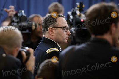 Alexander Vindman Photo - Director for European Affairs of the National Security Council US Army Lieutenant Colonel Alexander Vindman prior to testifying during the House Permanent Select Committee on Intelligence public hearing on the impeachment inquiry into US President Donald J Trump on Capitol Hill in Washington DC USA 19 November 2019 The impeachment inquiry is being led by three congressional committees and was launched following a whistleblowers complaint that alleges US President Donald J Trump requested help from the President of Ukraine to investigate a political rival Joe Biden and his son Hunter BidenCredit Shawn Thew  Pool via CNPAdMedia