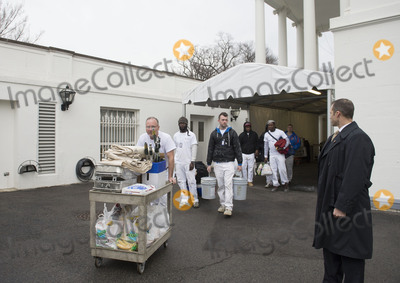 Barack Obama Photo - Painters and workers make their way towards the the West Wing as President Barack Obama prepares to leave the White House prior to President-Elect Donald Trumps arrival in Washington DC on January 20 2017 Later today Donald Trump will be sworn-in as the 45th President Photo Credit Kevin DietschCNPAdMedia