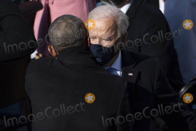 The Ceremonies Photo - UNITED STATES - January 20 Former President Barack Obama hugs President Joe Biden as he departs from the inaugural stage at the end of the ceremony after being sworn in as the 46th President of the United States by Supreme Court Chief Justice John Roberts on the West Front of the Capitol on Wednesday Jan 20 2021 (Photo by Caroline BrehmanCQ Roll Call)AdMedia