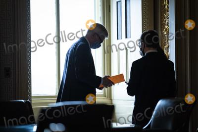 Bill Cassidy Photo - WASHINGTON DC - FEBRUARY 12 Sen Bill Cassidy R-La talks with staff in the Senate Reception room on the fourth day of the Senate Impeachment trials for former President Donald Trump on Capitol Hill on Friday Feb 12 2021 in Washington DC Credit Jabin Botsford  Pool via CNPAdMedia