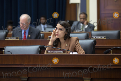 Alexandria Ocasio-Cortez Photo - United States Representative Alexandria Ocasio-Cortez (Democrat of New York) listens to the testimony of United States Secretary of the Treasury Steven T Mnunchin United States Secretary of Housing and Urban Development (HUD) Ben Carson and Director of the Federal Housing Finance Agency Mark Calabria during a US House Committee on Financial Services hearing on Capitol Hill in Washington DC US on October 22 2019Credit Stefani Reynolds  CNPAdMedia