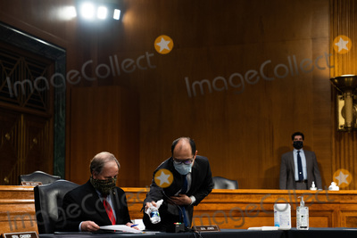 Alabama Photo - A staffer cleans a water bottle for United States Senator Doug Jones (Democrat of Alabama) at a US Senate Health Education Labor and Pensions Committee hearing on new coronavirus tests on Capitol Hill in Washington Thursday May 7 2020Credit Anna Moneymaker  Pool via CNPAdMedia