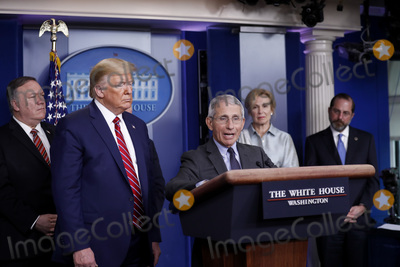 Alex Azar Photo - Director of the National Institute of Allergy and Infectious Diseases at the National Institutes of Health Dr Anthony Fauci center speaks as US President Donald J Trump second left listens during a Coronavirus Task Force news conference in the briefing room of the White House in Washington DC US on Friday March 20 2020 Americans will have to practice social distancing for at least several more weeks to mitigate US cases of Covid-19 Fauci said today Pictured behind the President and Fauci from left to right US Secretary of State Mike Pompeo Dr Deborah L Birx White House Coronavirus Response Coordinator and US Secretary of Health and Human Services (HHS) Alex AzarCredit Al Drago  Pool via CNPAdMedia