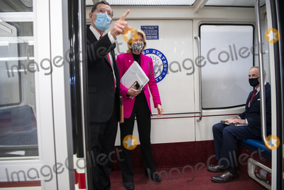 alaska Photo - UNITED STATES - FEBRUARY 9 From left Sens John Barrasso R-Wyo Lisa Murkowski R-Alaska and Tom Carper D-Del are seen in the senate subway after the first day of the impeachment trial of former President Donald Trump in the Capitol in Washington DC on Tuesday February 9 2021 Credit Tom Williams  Pool via CNPAdMedia