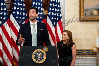 Fuel Photo - Libby Bish listens as Rafael Melo co-founders of Frontline Fuel speaks during a ceremony at the White House in Washington DC honoring volunteers helping others deal with coronavirus on Friday May 1 2020Credit Erin Schaff  Pool via CNPAdMedia