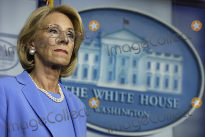 Devo Photo - United States Secretary of Education Betsy DeVos stands during a press briefing on the Coronavirus COVID-19 pandemic with members of the Coronavirus Task Force at the White House in Washington DC on March 27 2020 Credit Yuri Gripas  Pool via CNPAdMedia