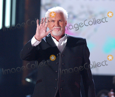 Grammy Awards Photo - 20 March 2020 - Kenny Rogers whose legendary music career spanned nearly six decades has died at the age of 81 Rogers was inducted to the Country Music Hall of Fame in 2013 He had 24 No 1 hits and through his career more than 50 million albums sold in the US alone He was a six-time Country Music Awards winner and three-time Grammy Award winner Some of his hits included Lady Lucille Weve Got Tonight Islands In The Stream and Through the Years His 1978 song The Gambler inspired multiple TV movies with Rogers as the main character File Photo June 9 2004 Nashville TN USA Singer KENNY ROGERS during CMT 100 Greatest Love Songs Telecast Taping held at Gaylord Entertainment Center Mandatory Credit Photo by Laura FarrAdMedia