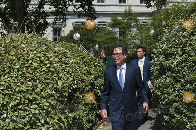 White House Photo - United States Secretary of the Treasury Steven Mnuchin makes his way to the West Wing at The White House following the Supreme Court ruling that a New York prosecutor is entitled to see President Trumps private and business financial records in Washington DC Thursday July 9 2020 Credit Rod LamkeyCNPAdMedia