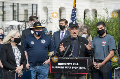 Jon Stewart Photo - Comedian Jon Stewart offers remarks during a press conference regarding legislation to assist veterans exposed to burn pits outside the US Capitol in Washington DC Tuesday September 15 2020  Standing at left is US Senator Kirsten Gillibrand (Democrat of New York)Credit Rod Lamkey  CNPAdMedia