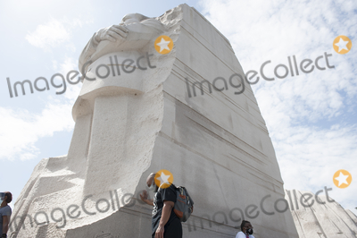 Martin Luther King Jr Photo - A man pauses in the extreme Summer heat at the base of the Martin Luther King Jr Memorial following the Get Your Knee Off Our Necks March on Washington at the Lincoln Memorial in Washington DC Friday August 28 2020 Credit Rod Lamkey  CNPAdMedia