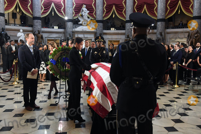 Alexandria Ocasio-Cortez Photo - United States Representative Adam Schiff (Democrat of California) waits in line as US Representative Alexandria Ocasio-Cortez (Democrat of New York) pays her respects to United States Representative Elijah Cummings (Democrat of Maryland) in National Statuary Hall at the United States Capitol on Thursday October 24 2019 in Washington DC The service preceded Cummings lying in state in front of the US House chamber Credit Matt McClain  Pool via CNPAdMedia