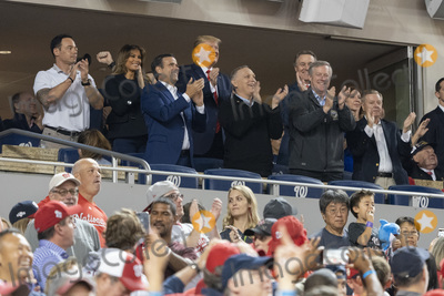 TI Photo - United States President Donald J Trump participates in a moment to salute the military during game five of the World Series at Nationals Park in Washington DC on October 27 2019  The Washington Nationals and Houston Astros are tied at two games going into tonights game Pictured with the president include US Representative John Ratcliffe (Republican of Texas) US Senator David Perdue (Republican of Georgia) US Representative Andy Biggs (Republican of Arizona) US Representative Mark Meadows (Republican of North Carolina) and US Senator Lindsey Graham (Republican of South Carolina) Credit Chris Kleponis  Pool via CNPAdMedia