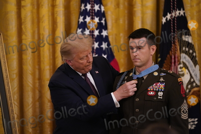 Thomas Payne Photo - United States President Donald Trump center presents the Medal of Honor to Sergeant Major Thomas Payne United States Army left in the East Room of the White House in Washington DC on September 11 2020 Payne is the 1st living Delta Force member to receive the Medal of Honor Credit Chris Kleponis  Pool via CNPAdMedia