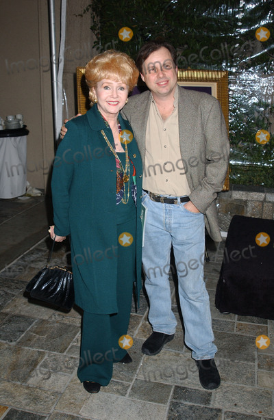 Debbie Reynolds Photo - 28 December 2016 - Debbie Reynolds the Oscar-nominated Singin in the Rain  singer-actress who was the mother of late actress Carrie Fisher has died She was 84 She wanted to be with Carrie her son Todd Fisher told Variety She was taken to the hospital from Todd Fishers Beverly Hills house Wednesday after a suspected stroke the day after her daughter Carrie Fisher died File Photo Dec 05 2003 Beverly Hills CA USA  Actress DEBBIE REYNOLDS and son TODD FISHER during the  Hollywood Collection Auction Preview held at Le Meridien Hotel Photo Credit Laura FarrAdMedia