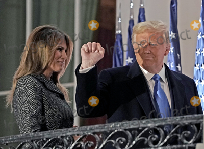 Supremes Photo - United States President Donald J Trump gestures to guests as he and First lady Melania Trump return to the Residence following the ceremony where Justice Amy Coney Barrett took the oath of office to be Associate Justice of the Supreme Court on the Blue Room Balcony of the White House in Washington DC US October 26 2020 Credit Ken Cedeno  Pool via CNPAdMedia