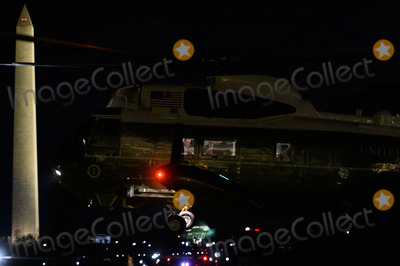 THE WINDOW Photo - Passengers are seen through the windows of Marine One as United States President Donald J Trump and first lady Melania Trump return to the White House in Washington DC after a trip to London for the NATO summit on Wednesday May 4 2019Credit Erin Scott  Pool via CNPAdMedia