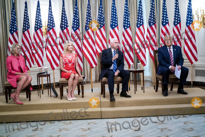 Devo Photo - From left to right United States Secretary of Education Betsy DeVos Senior Counselor Kellyanne Conway US Vice President Mike Pence and US President Donald J Trump as they participate in Kids First Getting Americas Children Safely Back to School event in the East Room of the White House in Washington DC  Wednesday August 12  2020 Credit Doug Mills  Pool via CNPAdMedia