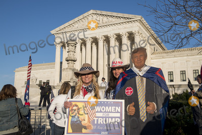 Supremes Photo - Erana Pulli left and her friend Michelle Mellor right pose with a cut-out of United States President Donald J Trump as they join thousands of supporters of United States President Donald J Trump filling the streets in front of the United States Supreme Court and the grounds of the US Capitol following a pro-Trump MAGA rally and march in Washington DC on Saturday November 14 2020Credit Rod Lamkey  CNPAdMedia