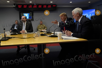 Alex Azar Photo - United States President Donald J Trump speaks during a teleconference with governors at the Federal Emergency Management Agency headquarters Thursday March 19 2020 in Washington DC  At left is US Secretary of Health and Human Services (HHS) Alex Azar and at right is US Vice President Mike PenceCredit Evan Vucci  Pool via CNPAdMedia