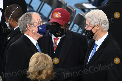 Bill Clinton Photo - Former US President George W Bush (L) Jym Clyburn from South Carolina and Former US President Bill Clinton (R) are seen before US president-elect Joe Biden is sworn in as the 46th US President on January 20 2021 at the US Capitol in Washington DC - Biden a 78-year-old former vice president and longtime senator takes the oath of office at noon (1700 GMT) on the US Capitols western front the very spot where pro-Trump rioters clashed with police two weeks ago before storming Congress in a deadly insurrection (Photo by Saul LOEB  POOL  AFP)AdMedia