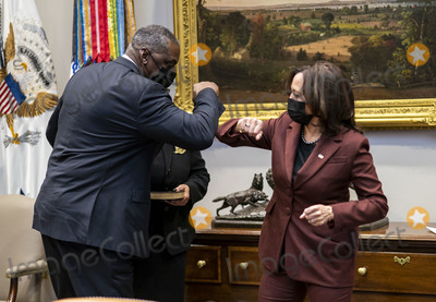 White House Photo - United States Vice President Kamala Harris and US Secretary of Defense Lloyd J Austin III bump elbows after taking part in a ceremonial swearing-in ceremony in the Roosevelt Room of the White House in Washington DC on Monday January 25 2021Credit Doug Mills  Pool via CNPAdMedia