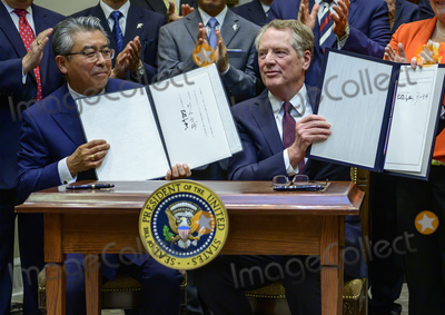 The Used Photo - Ambassador Shinsuke Sugiyama Ambassador of Japan to the United States left and US Trade Representative Robert Lighthizer right hold up the documents for the cameras aster they signed the US-Japan Trade Agreement and US-Japan Digital Trade Agreement in the Roosevelt Room of the White House in Washington DC on Monday October 7 2019 Photo Credit Ron SachsCNPAdMedia