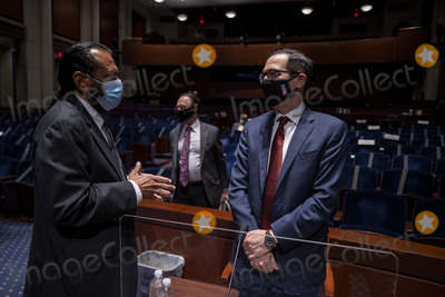 Al Green Photo - United States Representative Al Green (Democrat of Texas)  and  US Secretary of the Treasury Steven Mnuchin greet each other after testifying before the House Financial Services Committee on Capitol Hill on June 30 2020 in Washington DC Federal Reserve Chairman Jerome Powell and Treasury Secretary Steven Mnuchin testified on their agencies response to the coronavirus pandemic Credit Tasos KatopodisCNPAdMedia