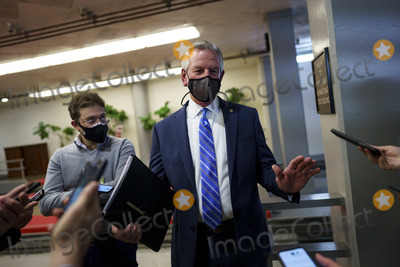 Alabama Photo - Senator Tommy Tuberville a Republican from Alabama wears a protective mask while speaking to members of the press in the Senate Subway at the US Capitol in Washington DC US on Thursday Feb 11 2021 House prosecutors used the second day of Donald Trumps impeachment trial to detail a months-long campaign by the former president to stoke hatred and encourage violence over the election results that they said culminated in the mob attack on the US Capitol that he then did little to stop Credit Ting Shen - Pool via CNPAdMedia