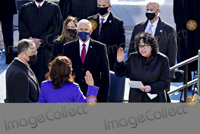 Supremes Photo - Sonia Sotomayor associate justice of the US Supreme Court right administers the oath of office to US Vice President-elect Kamala second left during the 59th presidential inauguration in Washington DC US on Wednesday Jan 20 2021 Biden will propose a broad immigration overhaul on his first day as president including a shortened pathway to US citizenship for undocumented migrants - a complete reversal from Donald Trumps immigration restrictions and crackdowns but one that faces major roadblocks in Congress Photographer Kevin DietschUPIAdMedia
