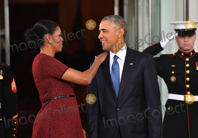 Barack Obama Photo - President Barack Obama (R) and Michelle Obama share a moment as they wait for President-elect Donald Trump and wife Melania at the White House before the inauguration on January 20 2017 in Washington DC  Trump becomes the 45th President of the United States Photo Credit Kevin DietschCNPAdMedia