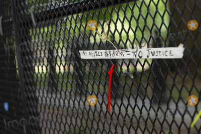 TI Photo - Ties are left over from signs that were displayed on the additional White House fencing in Washington DC US on Wednesday June 10 2020  Additional fencing had been set up near the White House in response to the demonstrations caused by the death of George Floyd while he was in police custody on May 25 2020  Credit Stefani Reynolds  CNPAdMedia