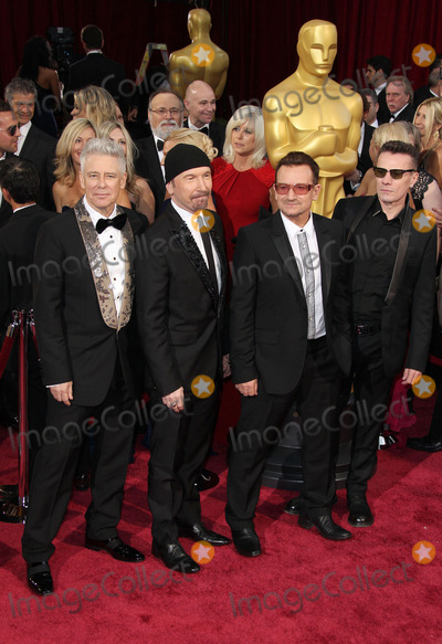 Adam Clayton Photo - 02 March 2014 - Hollywood California - Adam Clayton The Edge Bono and Larry Mullen Jr U2 86th Annual Academy Awards held at the Dolby Theatre at Hollywood  Highland Center Photo Credit Russ ElliotAdMedia
