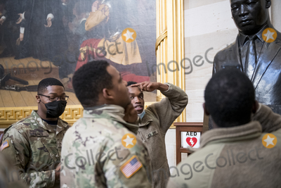 The National Photo - Members of the National Guard take photos of the statue of Martin Luther King Jr in the Rotunda at the US capitol as the House of Representatives vote on H Res 24 Impeaching Donald John Trump President of the United States for high crimes and misdemeanors at the US Capitol in Washington DC Wednesday January 13 2021 Credit Rod Lamkey  CNPAdMedia