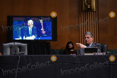 Barack Obama Photo - United States Senator Joe Manchin III (Democrat of West Virginia) right speaks during a Senate Veterans Affairs Committee confirmation hearing for Denis McDonough US secretary of Veterans Affairs (VA) nominee for US President Joe Biden left in Washington DC US on Wednesday Jan 27 2021 As Barack Obamas chief of staff McDonough oversaw the VAs overhaul in response to its 2014 wait-time scandal and previously served as a deputy national security adviser Credit Sarah Silbiger  Pool via CNPAdMedia