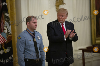 Police Officer Photo - United States President Donald J Trump presents the Medal of Valor to Dayton Police Officer Brian Rolfes during an East Room ceremony at the White House in Washington DC US on September 9 2019  Credit Stefani Reynolds  CNPAdMedia