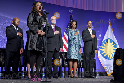 First Lady Michelle Obama Photo - United States President Barack Obama and First Lady Michelle Obama listen to the National Anthem sung by Denyce Graves at the groundbreaking ceremony of the Smithsonian National Museum of African American History and Culture in Washington DC on Wednesday February 22 2012 The museum is scheduled to open in 2015 and will be the only national museum devoted exclusively to the documentation of African American life art history and culture From left to right US Representative John Lewis (Democrat of Georgia) Denyce Graves Wayne Clough Secretary Smithsonian Institution Mrs Obama and President ObamaCredit Andrew Harrer  Pool via CNPAdMedia