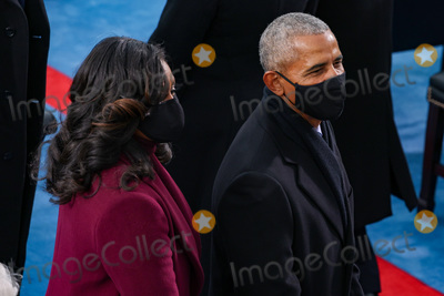 First Lady Michelle Obama Photo - WASHINGTON DC - JANUARY 20 Former US President Barack Obama and former first lady Michelle Obama arrive to the inauguration of US President-elect Joe Biden on the West Front of the US Capitol on January 20 2021 in Washington DC  During todays inauguration ceremony Joe Biden becomes the 46th president of the United States (Photo by Tasos KatopodisGetty Images)AdMedia