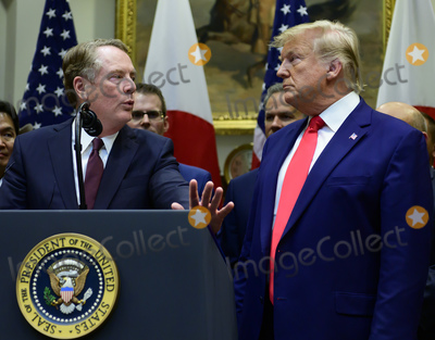 The Used Photo - United States Trade Representative Robert Lighthizer left makes remarks as US President Donald J Trump right listens prior to the signing of the US-Japan Trade Agreement and US-Japan Digital Trade Agreement in the Roosevelt Room of the White House in Washington DC on Monday October 7 2019 Photo Credit Ron SachsCNPAdMedia